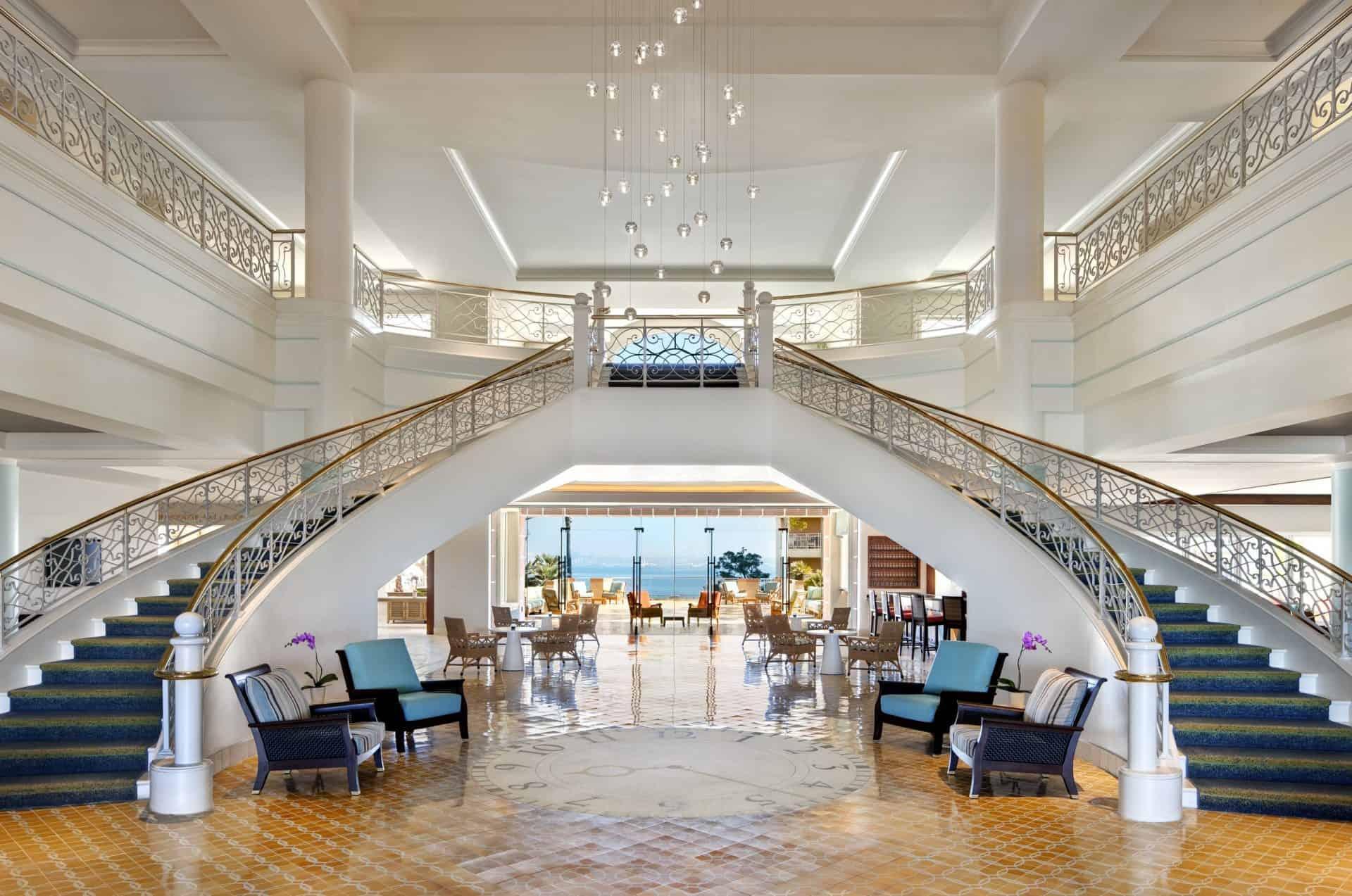 Loews Coronado Bay Resort California lobby staircase with yellow tiles and ocean views