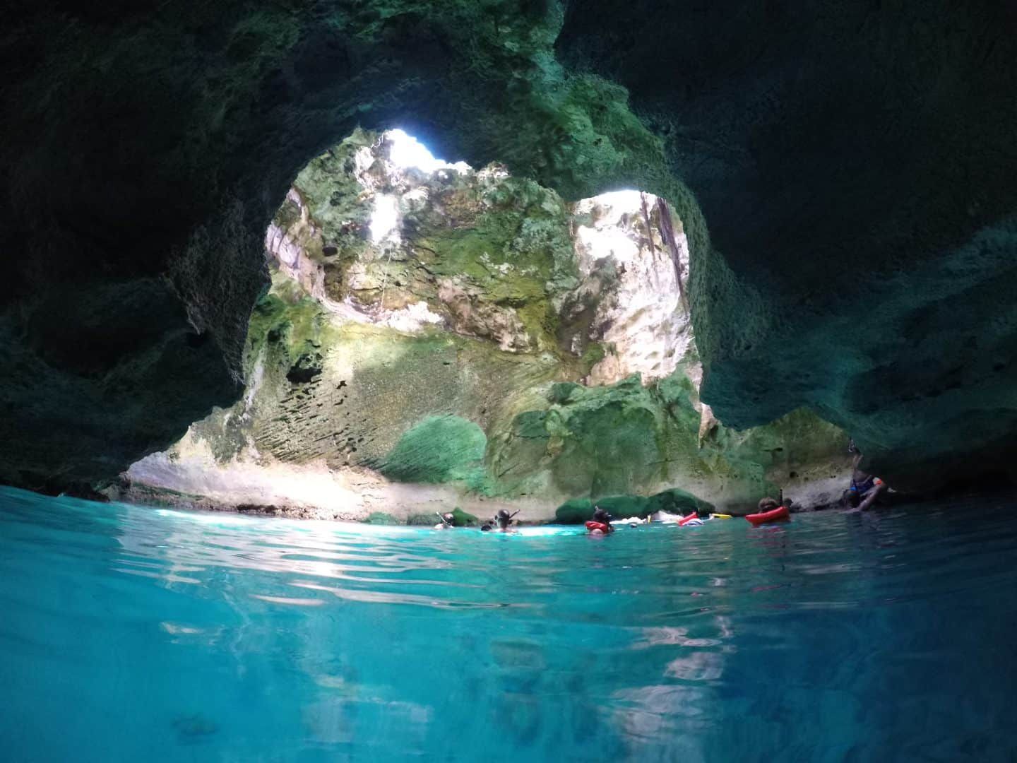 Things to do in Exuma: The Ultimate GuideBahamas Thunderball Grotto snorkelling in the grotto in blue water