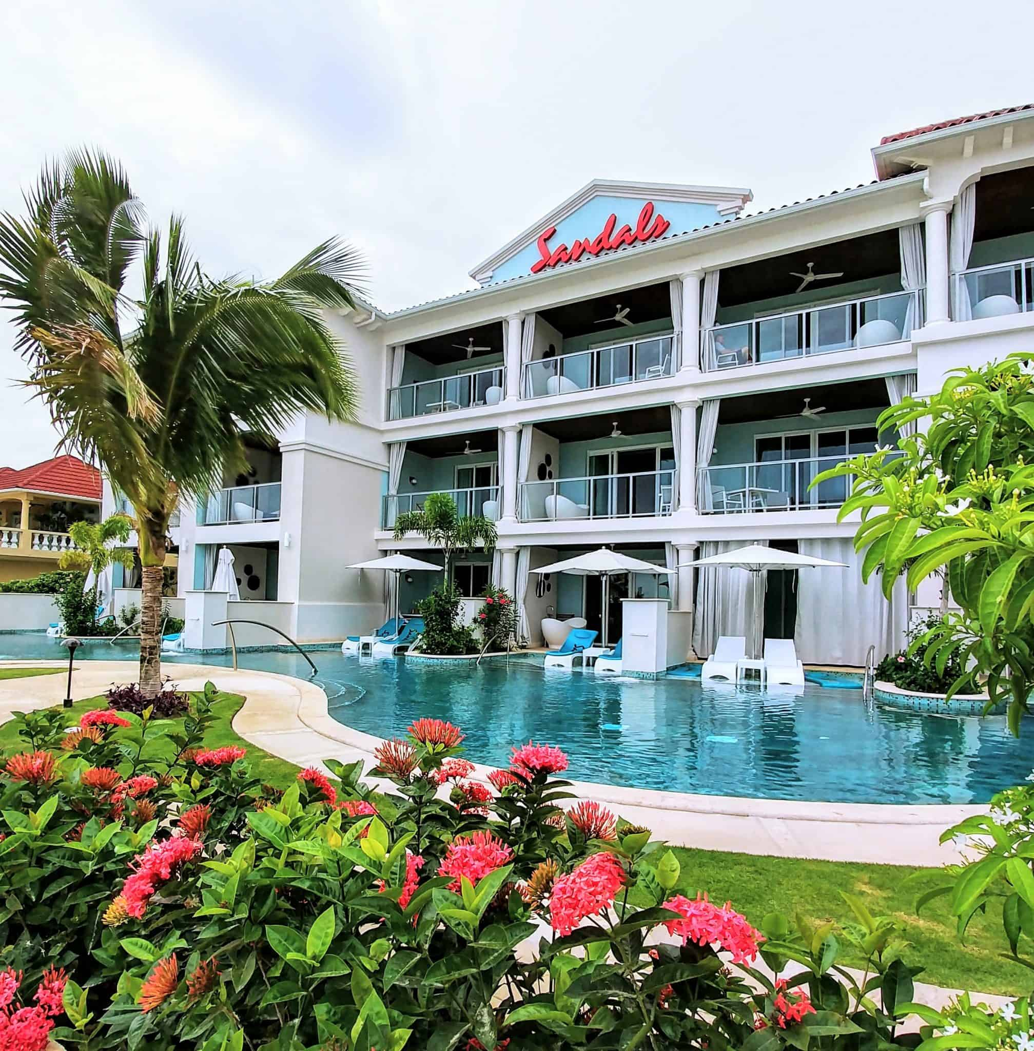 Luxury Couples Getaway - Sandals Montego Bay Jamaica Sandals resort with swim up pools from room with loungers and bathtubs on balcony