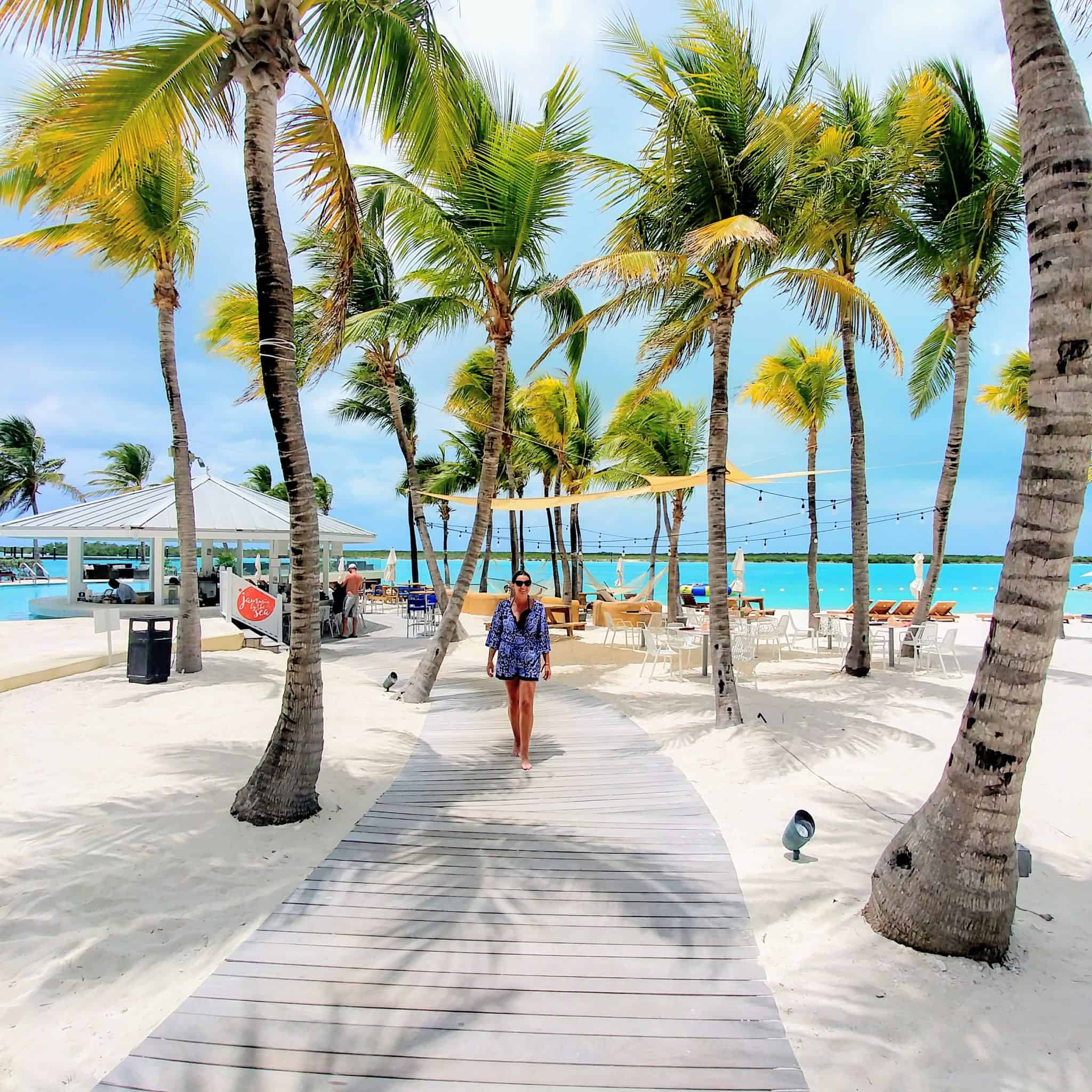 beach boardwalk with palm trees blue haven resort turks and caicos