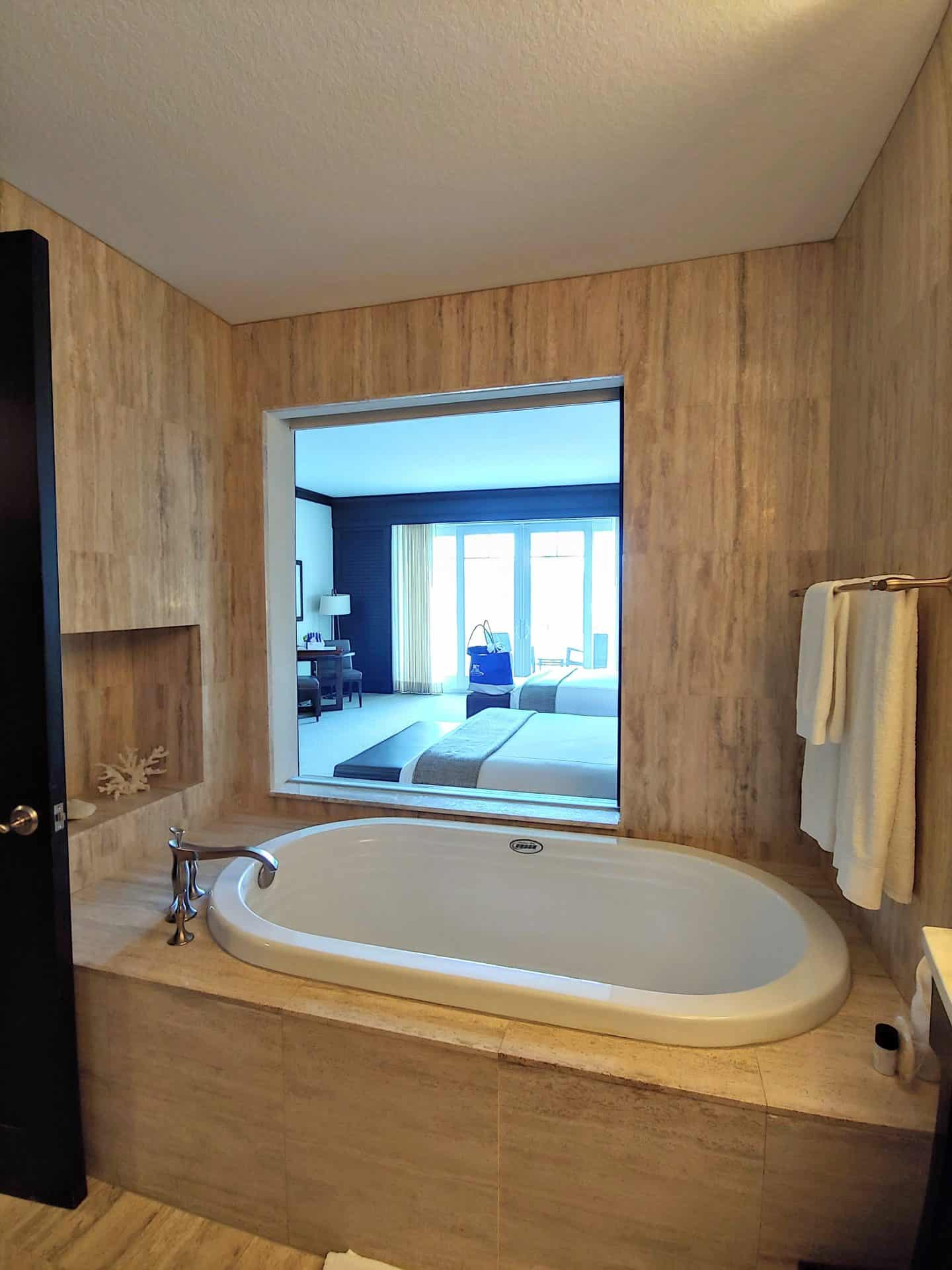soaker tub overlooking bedroom