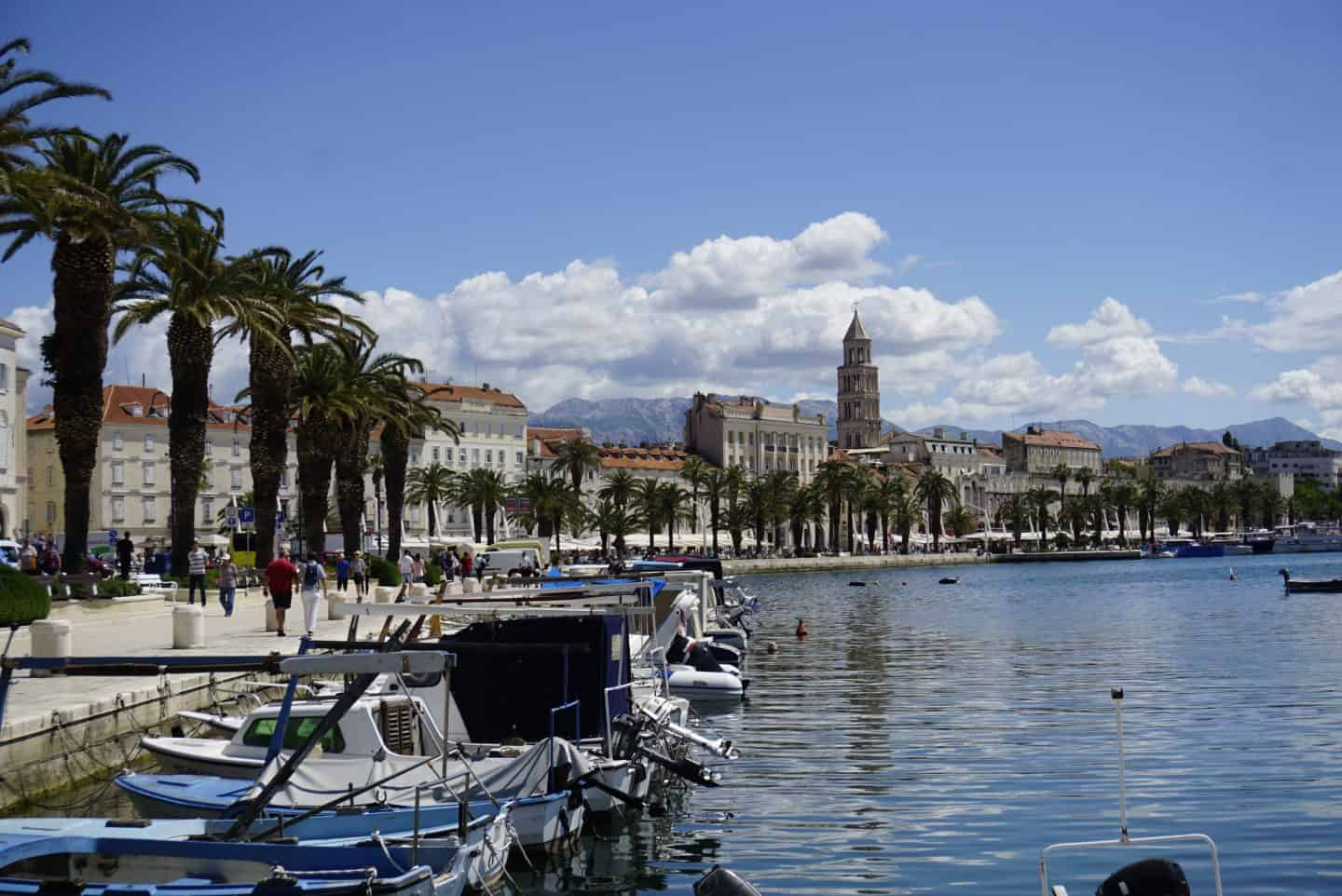 Split's promenade along side the Adriatic, overlooking Diocletian's Palace, with the Dinaric Alps in the background.