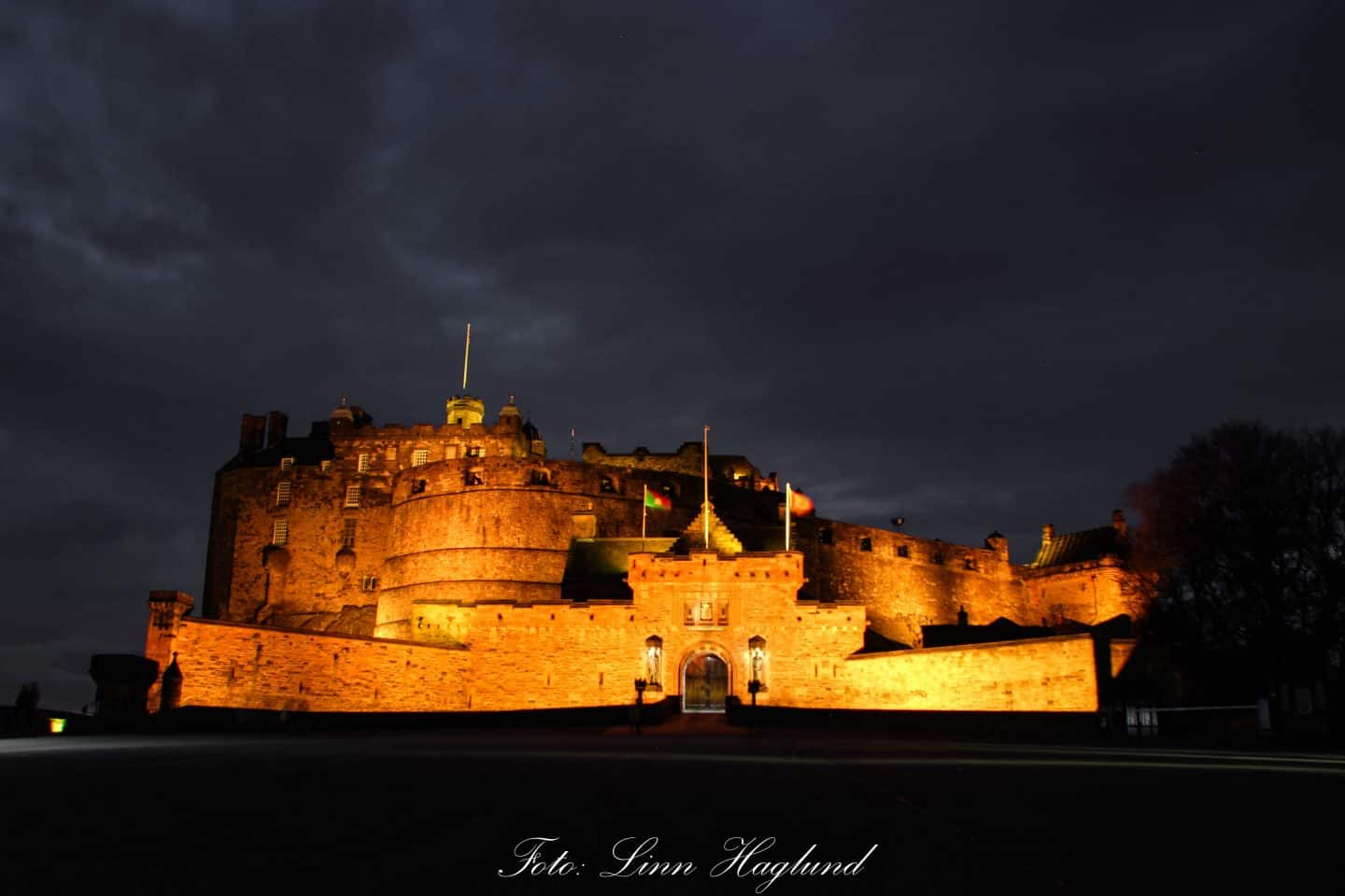 Edinburgh Castle lit up at night.