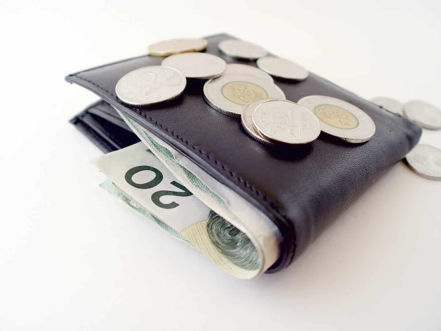 Wallet with coins on top