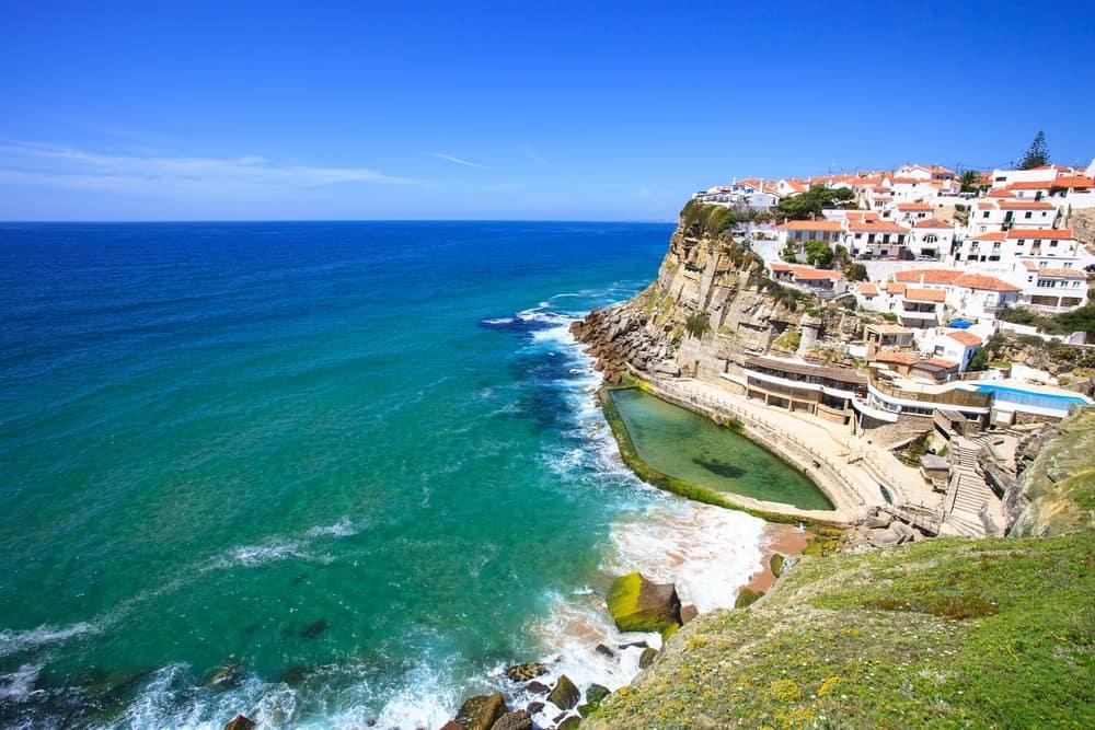 Azenhas do Mar white village landmark on the cliff and Atlantic ocean, Sintra, Lisbon, Portugal, Europe.